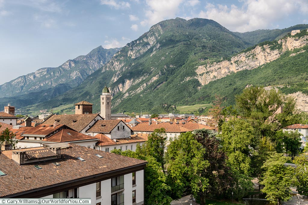 The view from the hotel rooftop across the ochre tiled roofs of Trento with the Dolomite mountains in the background.