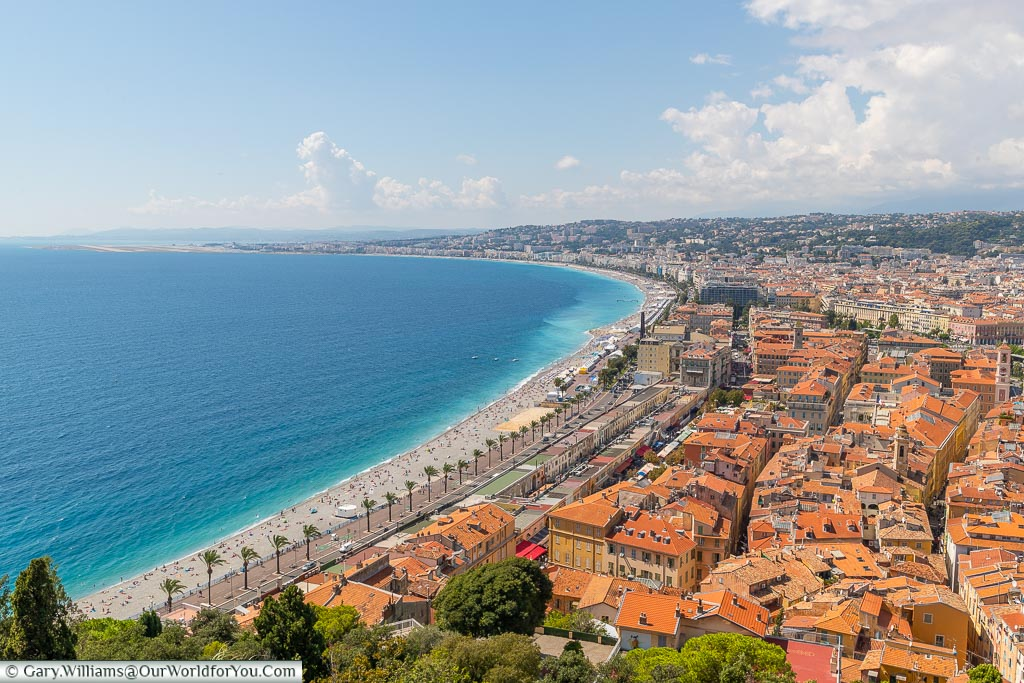 Overlooking Nice from Castle Hill with the sparkling azure waters of the French Riviera on the left and the orange tiled roofs of the old town to the right.