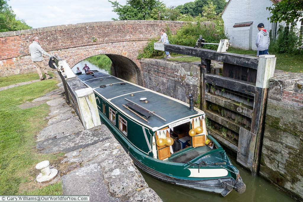 Our canal boat is entering a lock.  It's an all-hand job with a couple on the lock gates while the 'skipper' pilots the vessel into the narrow lock.