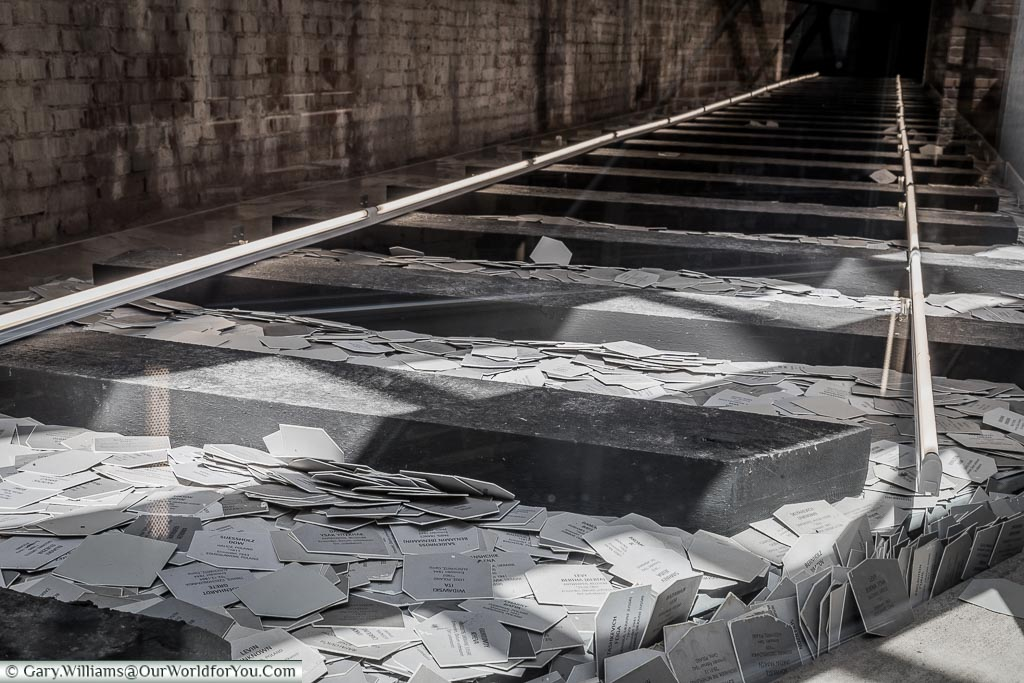 An installation depicting the railway lines to a concentration camp littler with name tags of the victims of the Nazi-era atrocities.
