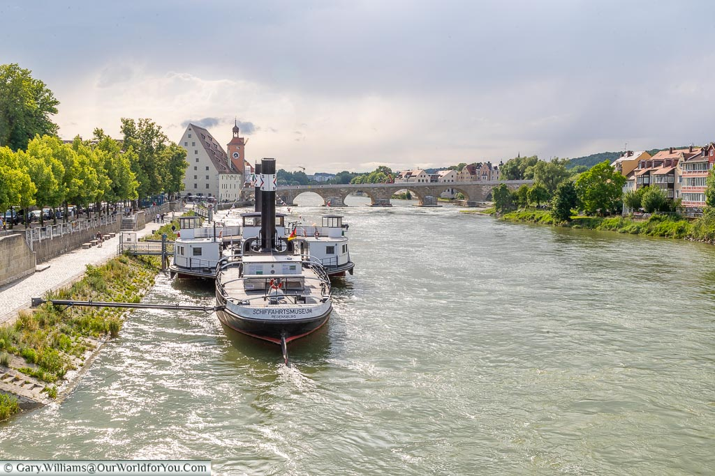 Looking along the Danube to the old stone bridge of Regensburg