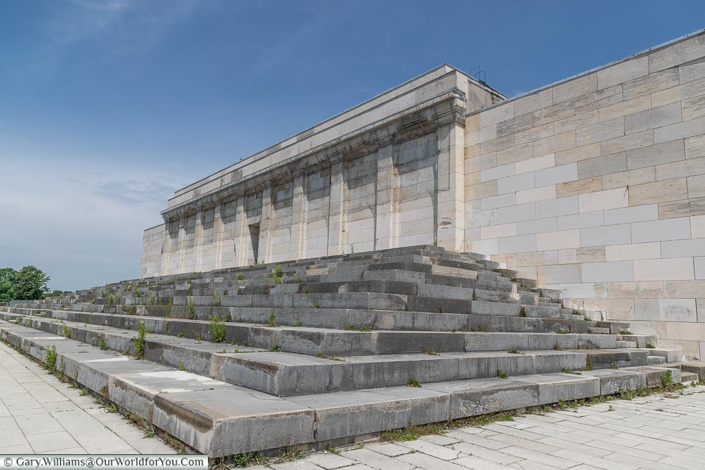 At the top of the Nazi Party Zeppelinfeld Grandstand looking toward the back with the final set of steps before the neoclassical facade.