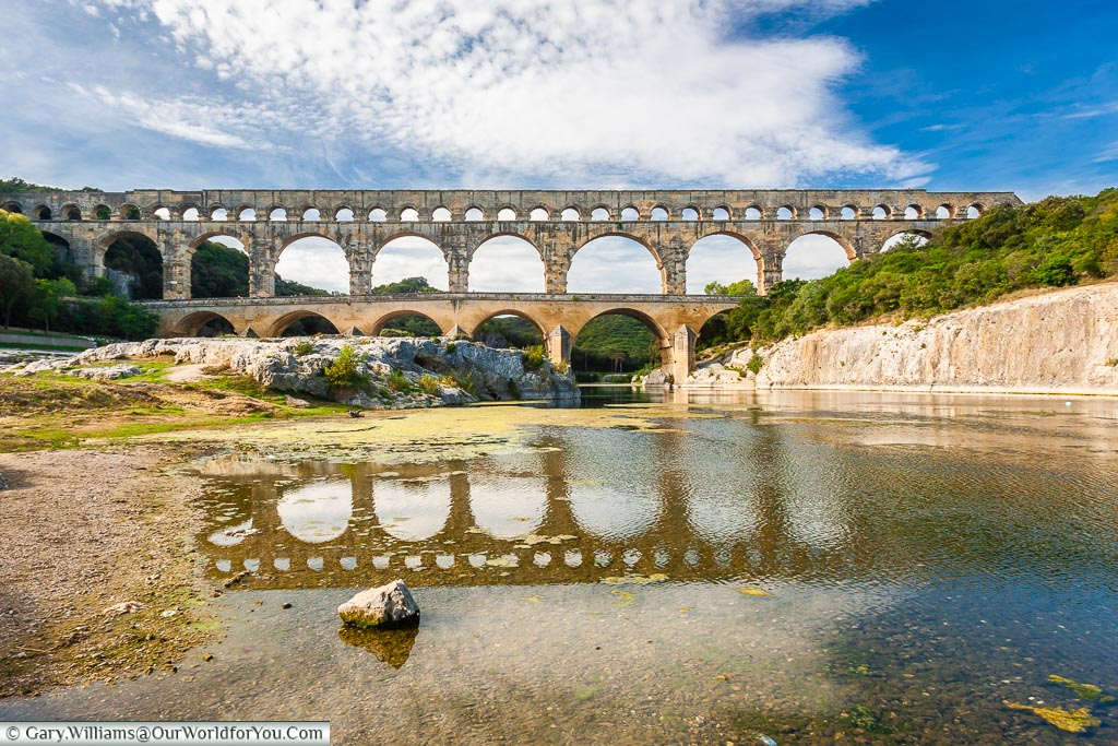 The historic Roman aqueduct of Pont du Gard.  Three levels of arches carrying water over the river Gardon.