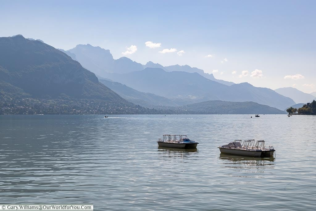 Two boats on a hazy Lake Annecy.