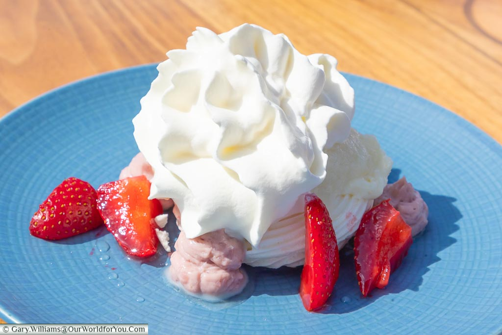 The final dessert course of strawberries & ginger pavlova with ginger sorbet.