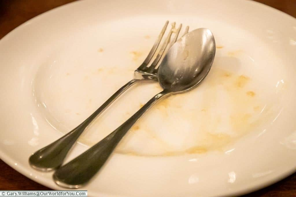 An empty plate after Gary had finished his dessert.