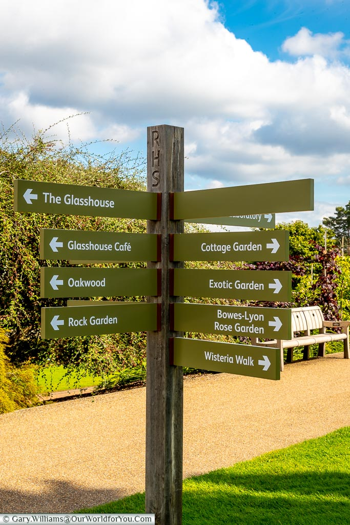 A signpost pointing to different parts of the various gardens.