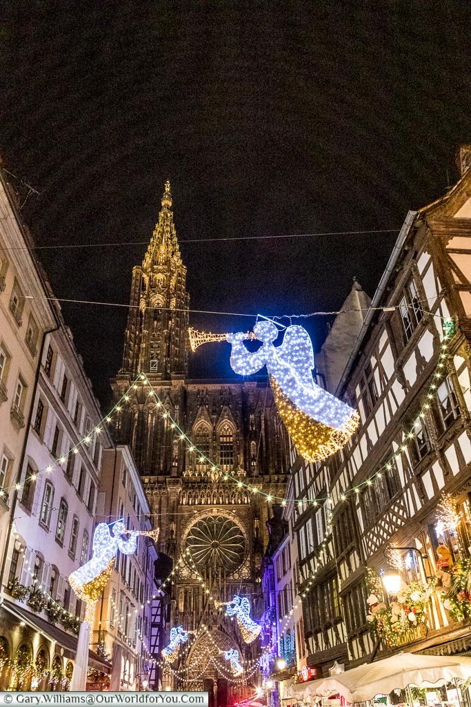 Angels with trumpets illuminate the way along Rue Mercière to Strasbourg's cathedral.
