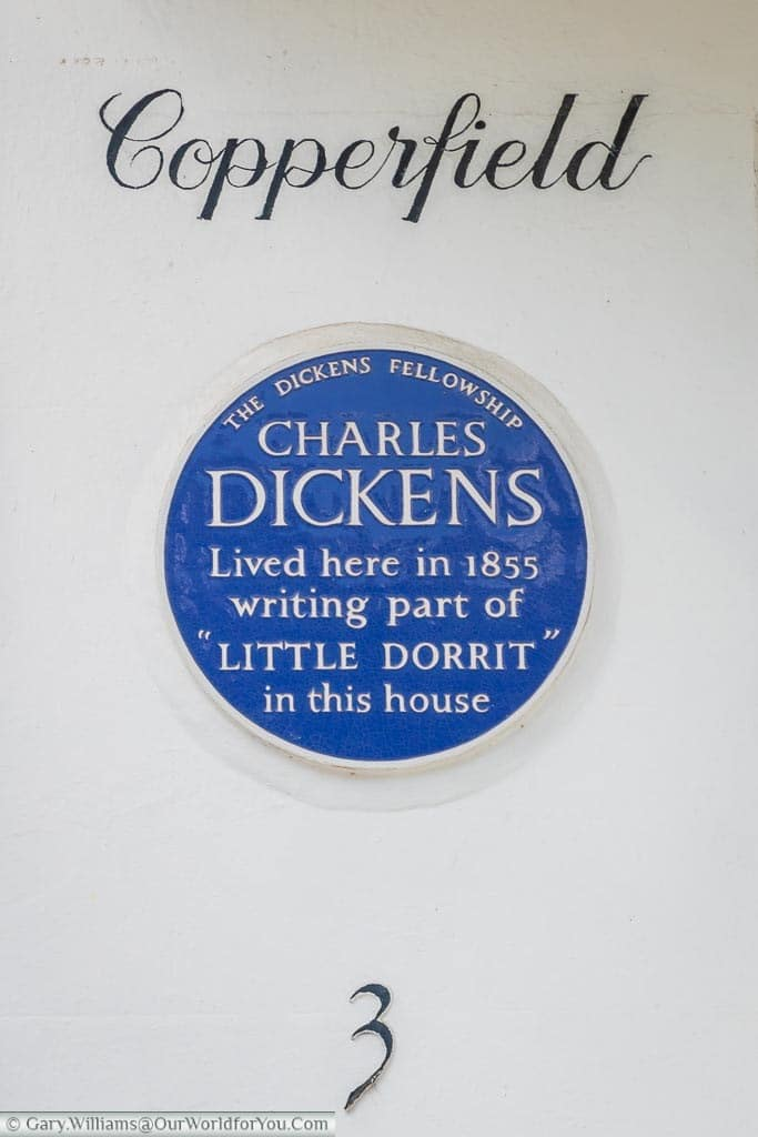 "A blue plaque issued by the Dickens Fellowship on a residence in Folkestone.  The plaque reads ""Charles Dickens lived here in 1855 writing part of Little Dorrit in this house""."