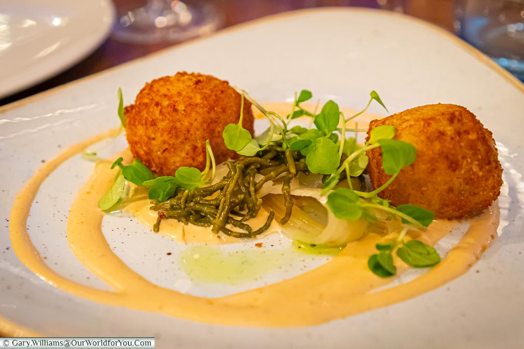 Gary's starter of Bon bon crab. Two deep-fried breaded balls of crab meat set on brown crab mayonnaise and samphire salad.