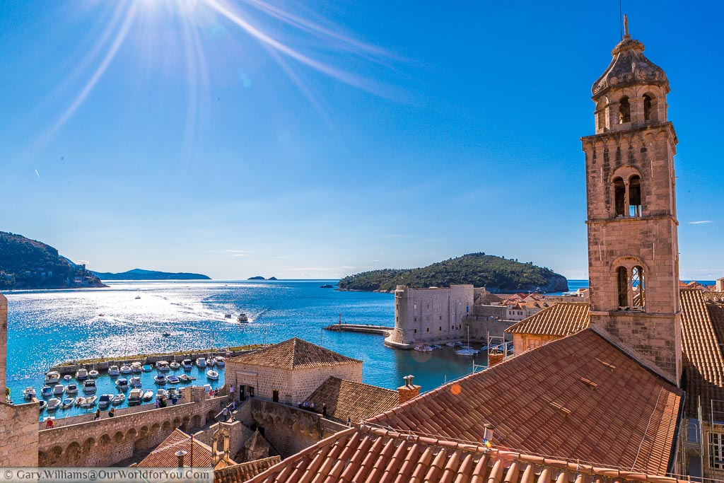 A view from the old city walls of Dubrovnik across the Adriatic to the harbour where small boats come and go.