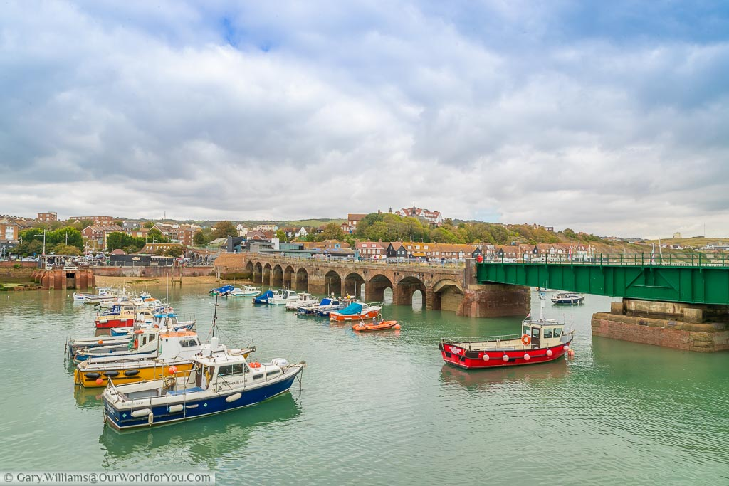 Boats in the harbour in front of the Harbour viaduct, and the green swing bridge leading to the old Folkestone Harbour Station.