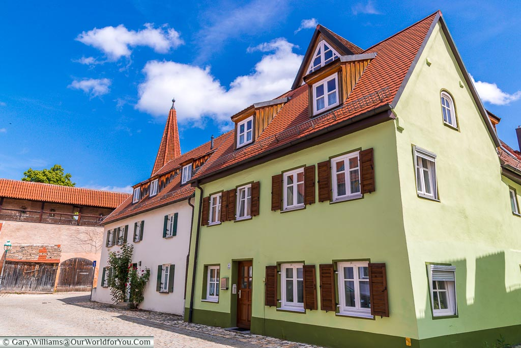 A couple of beautifully maintained homes next to the old town walls.