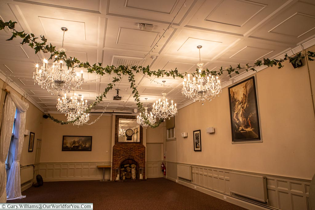 One of the old buildings now converted to a function room with its ornate chandeliers, historical artwork, ready to set-up for somebody's special day.