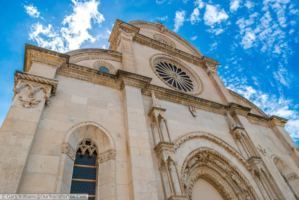 Looking up at the ornate facade of the Cathedral of St James in Šibenik.
