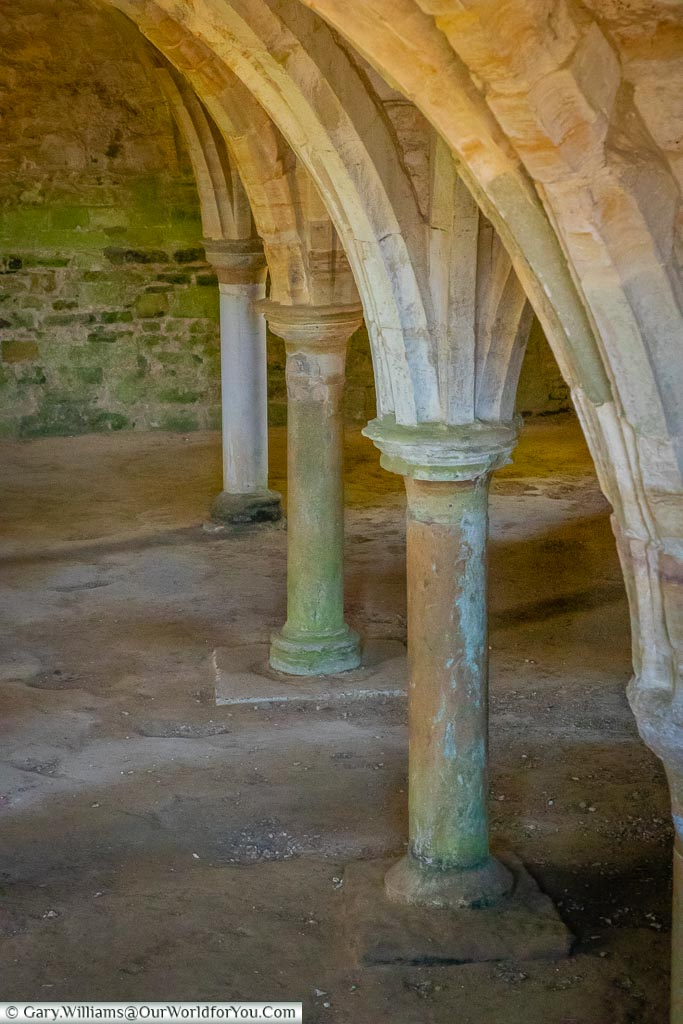 A close-up of the columns under the Abbey dormitory.