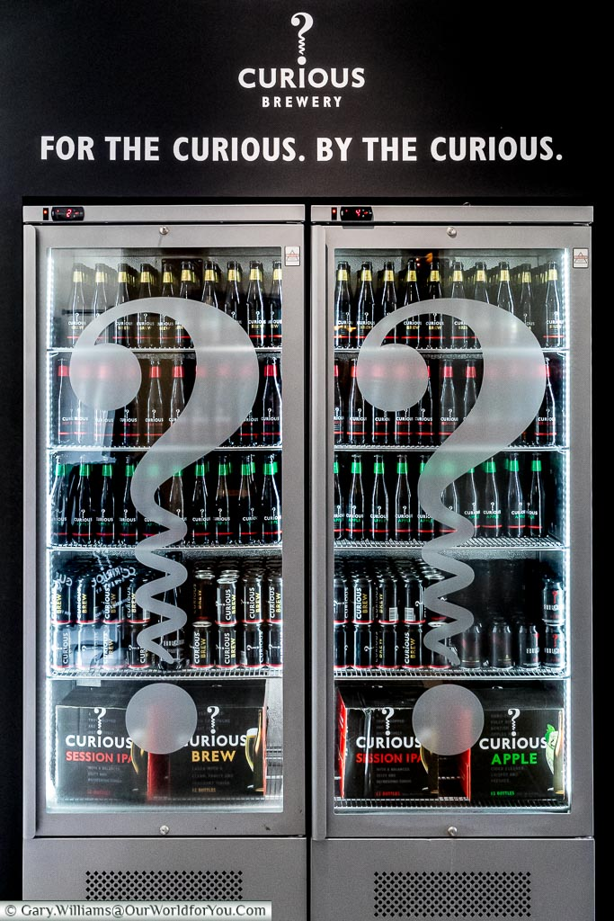 A large double glass fronter chiller full of Curious Brew,  Chapel Down's beer & cider brand.