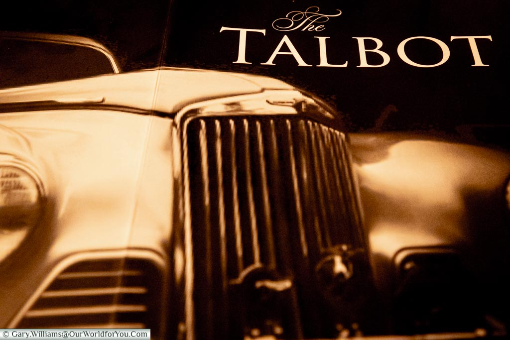 A grill of a Talbot motor car from the late 40's adorning the back of the dessert menu.
