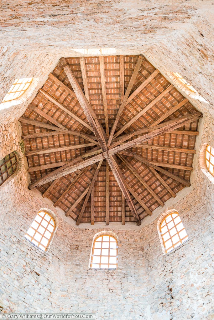 Looking up inside the bell tower to the wooden floor of the bell chamber.