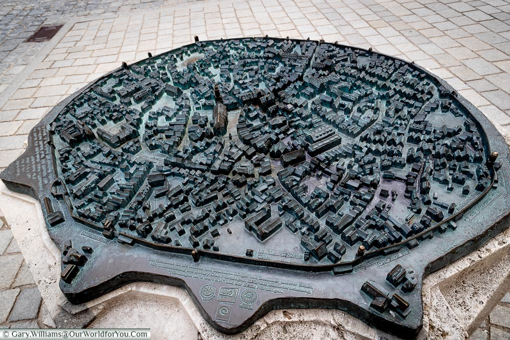 A brass tactile town map of the old town inside the city walls.
