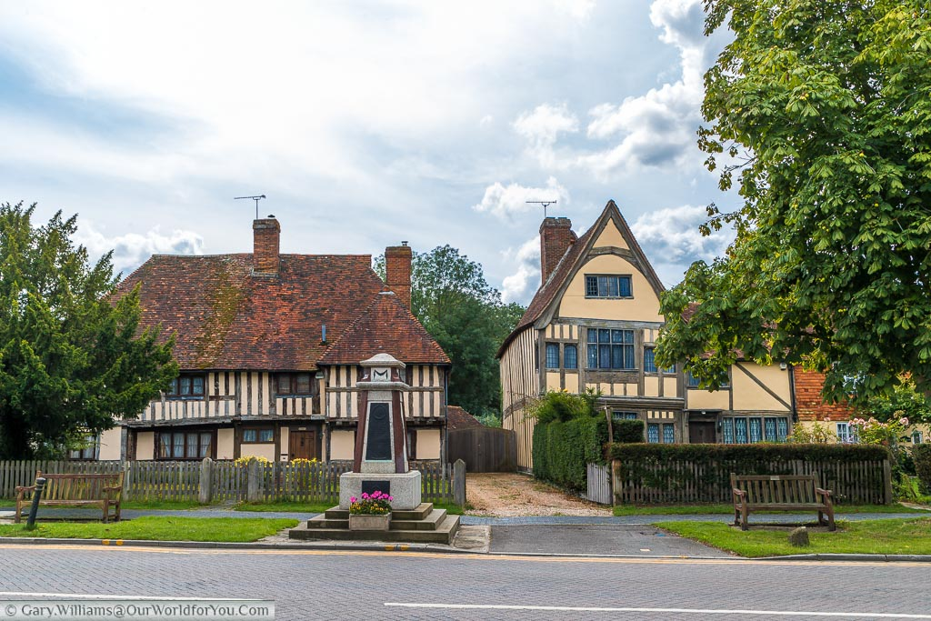 Looking across the High Street to 'The Chequers' and Shakespeare's house, behind the village War Memorial