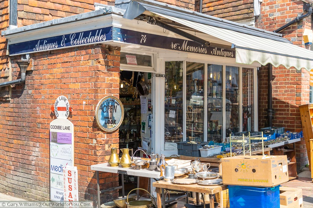 The collection of trestle tables outside antiques and collectables shop displaying all manner of bric-a-brac.