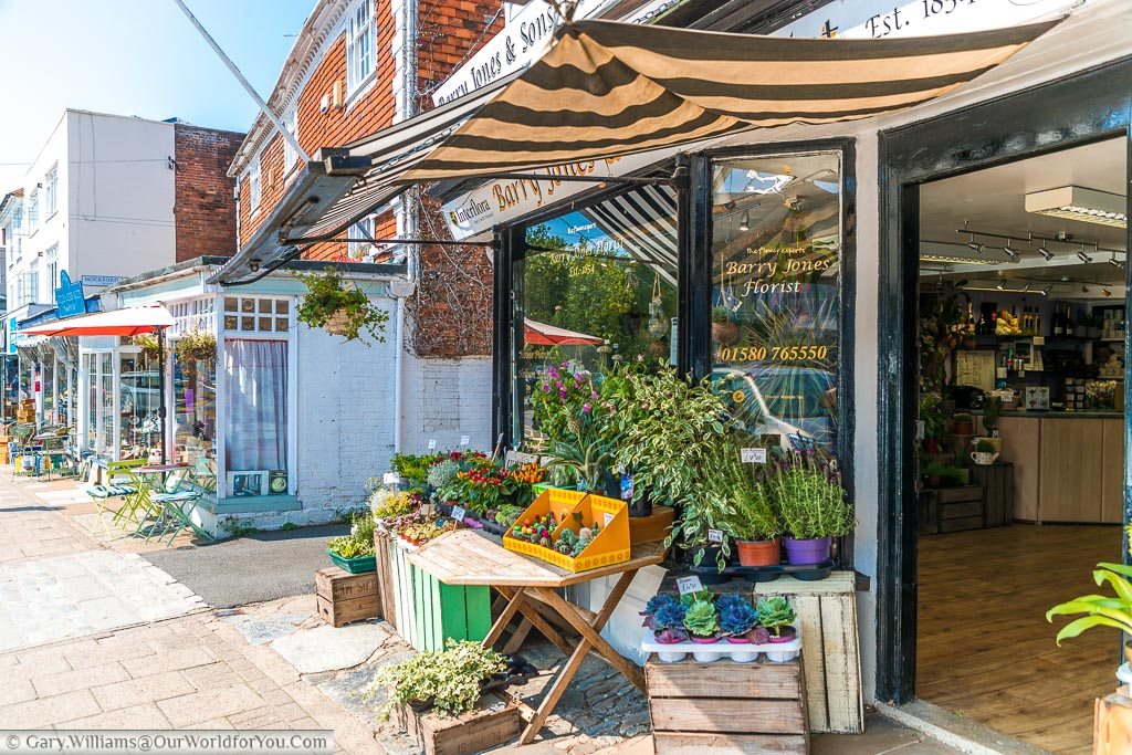 A florist in the High Street alongside other shops and cafes.  All very picturesque.