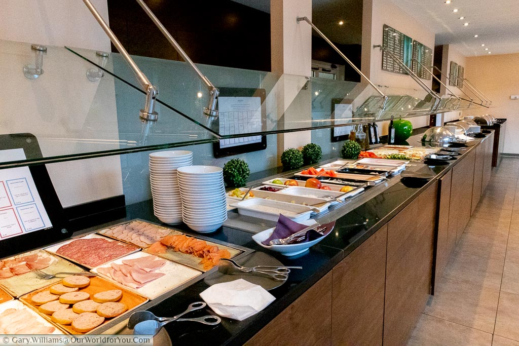 The breakfast counter of the Mercure Hotel Aachen Europaplatz.  A wide away of choice on the continental buffet at this comfortable, modern, hotel.