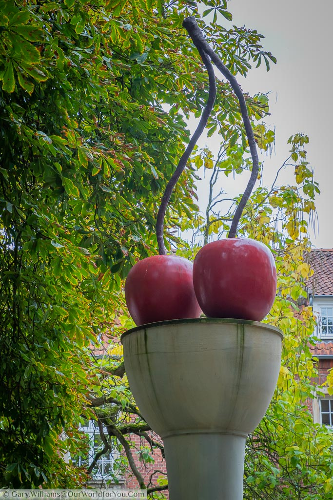 An art instaltion of two cherries on a column by Thomas Schütte.  One of the many pieces of public art in the city.