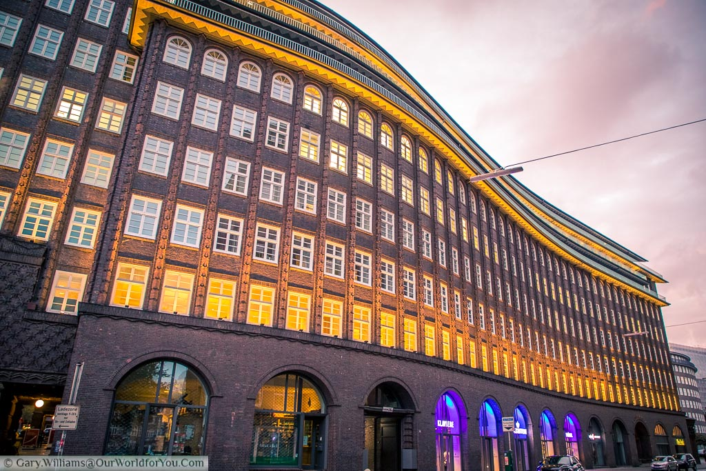 The beautiful curves of the brick-built, Chilehaus office building, From the 1920s at dusk.  this beautiful complex is another side to Hamburg.