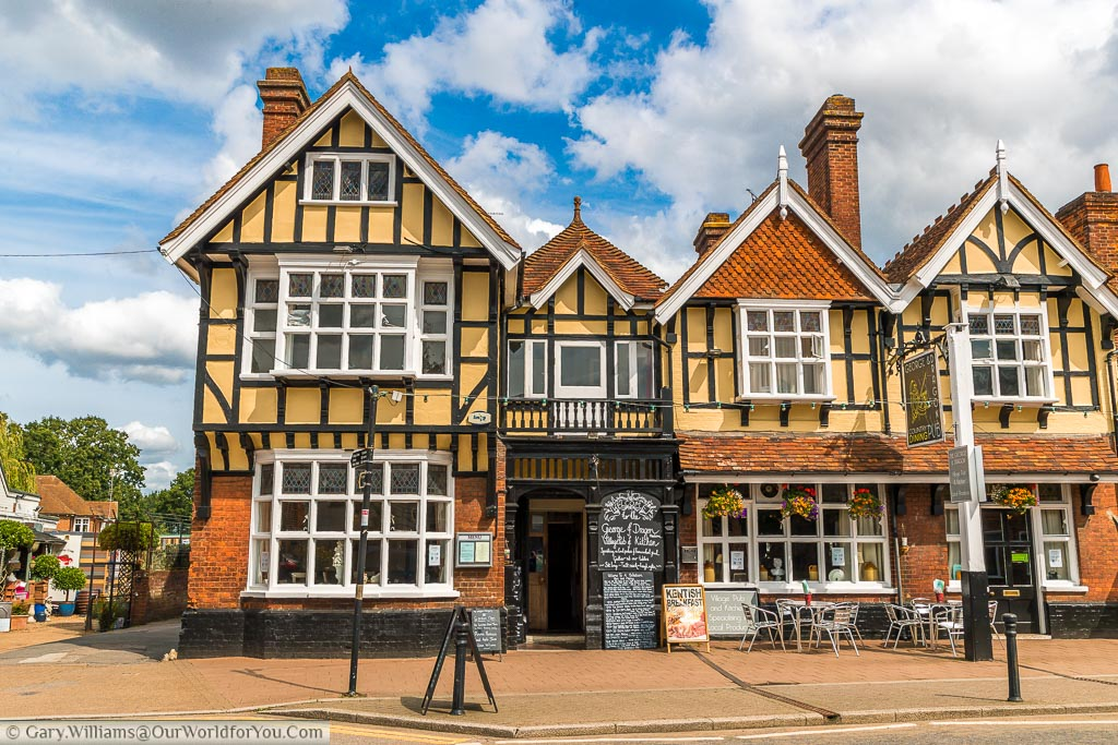 The George and Dragon pub on the High Street built in a Tudor style.