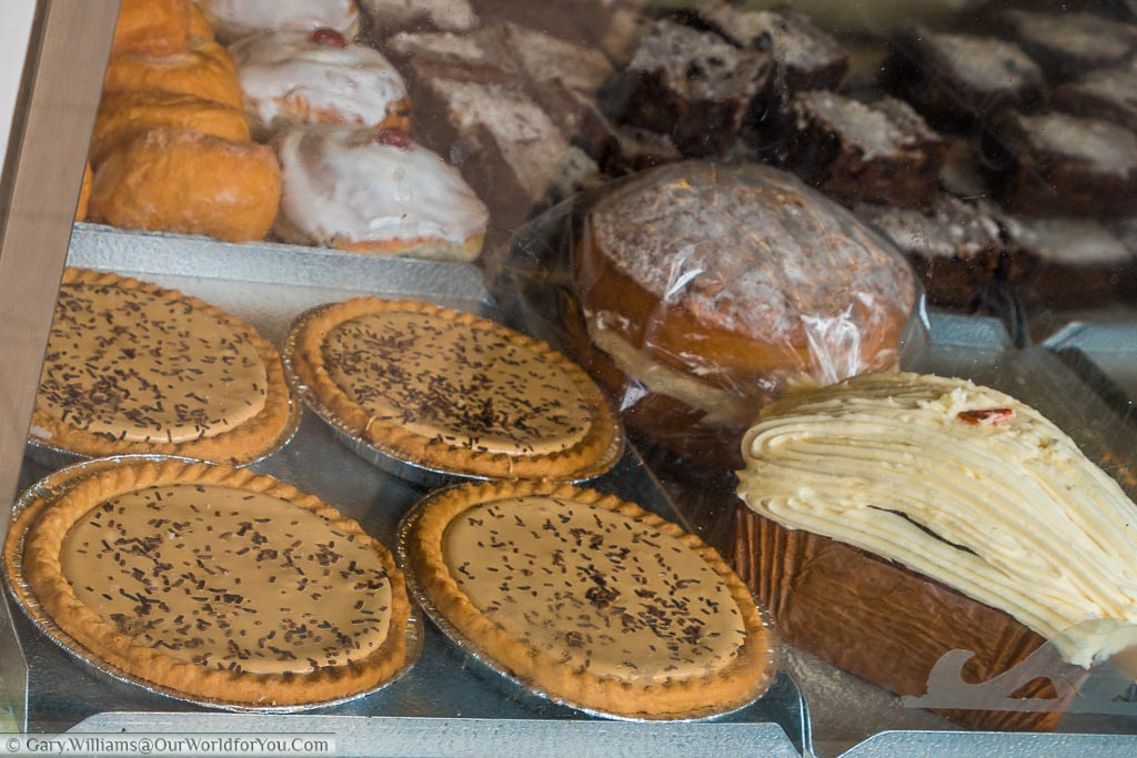 Four homemade gypsy tarts in the window of traditional bakers in Headcorn. Gypsy tarts of a local speciality of Kent.