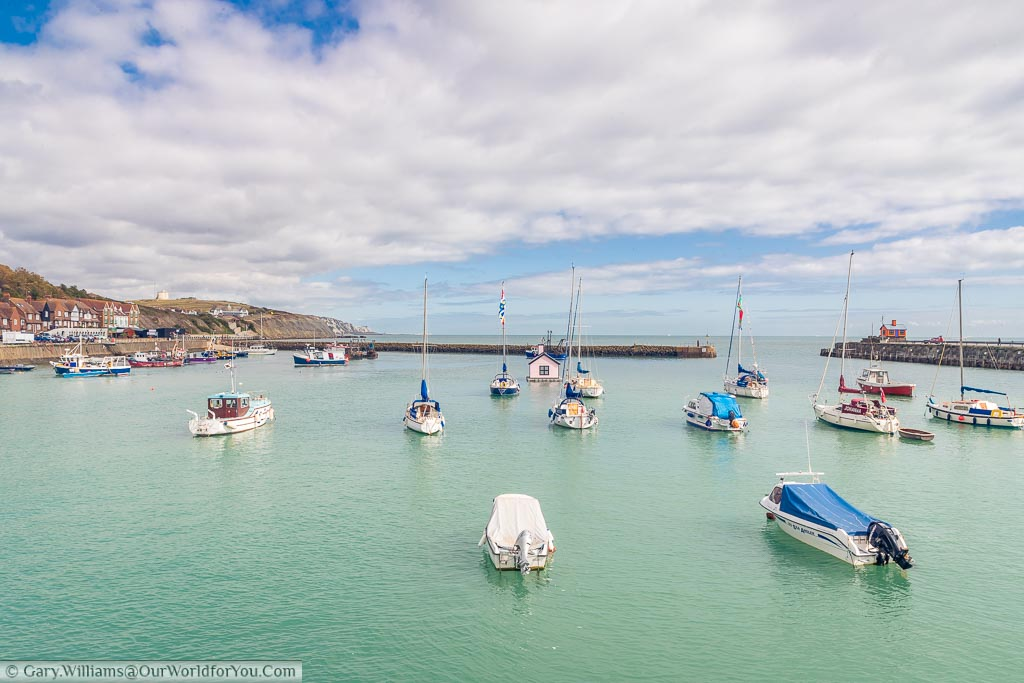 A view of with boats in Folkestone Harbour with a pink version of Holiday Home – By Richard Woods in the centre.