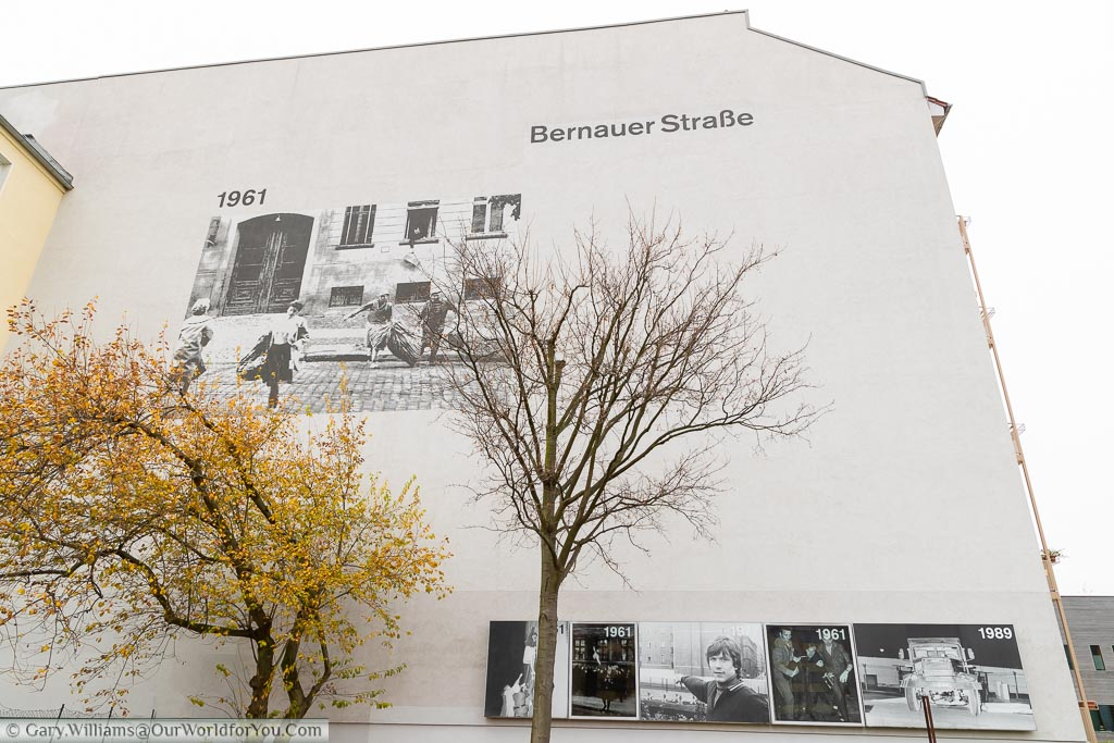 A large picture of people fleeing across the street on a building on Bernauer Strasse.