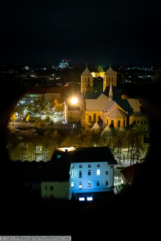 Looking through the Neogothic spire of St. Lamberti church down to St Paulus Dom at night.