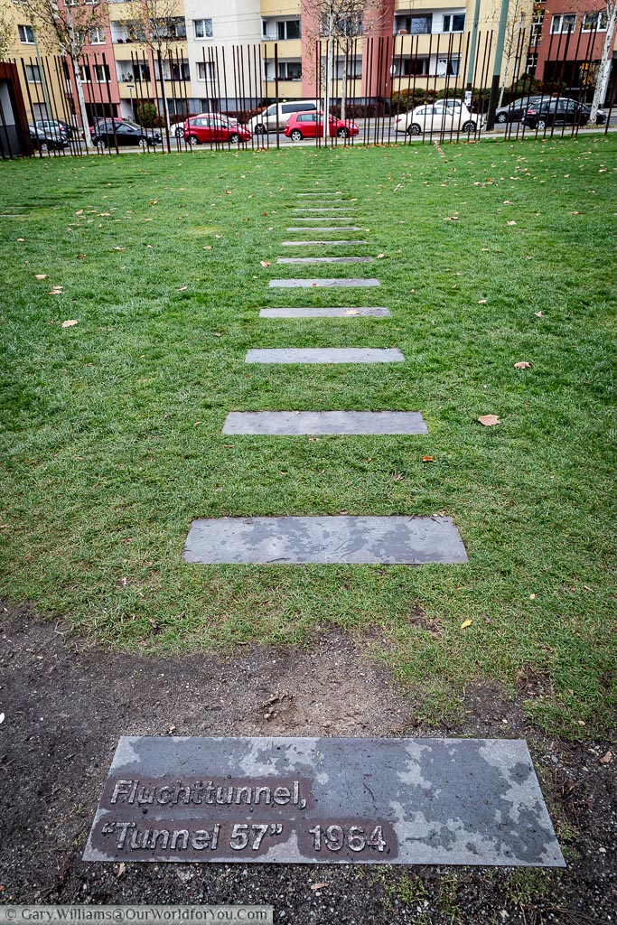 "Steel stepping-stones across the grass of no-man's-land marks out the path of ""Tunnel 57"", another attempt to breach the Berlin Wall."
