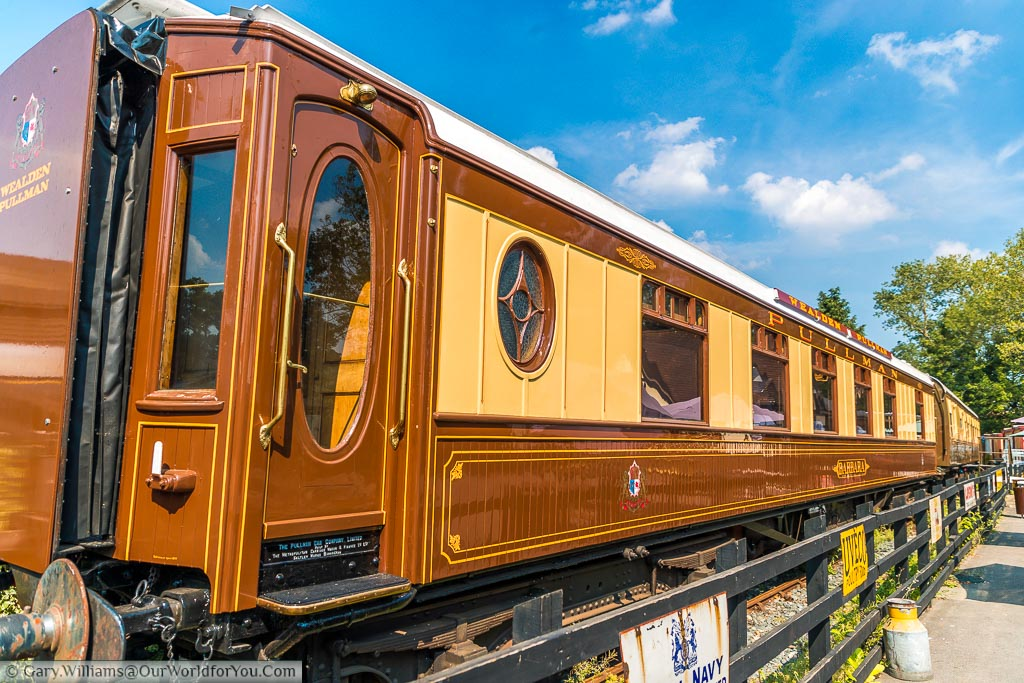 Tan & cream Pullman carriages in the sidings at Tenterden steam railway.