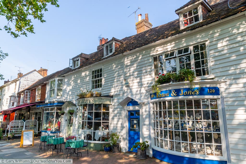 A selection of antique shops and tea houses line the old High Street in period buildings.  Tables and chairs line the streets while antiques and bric-a-brac fill the windows.