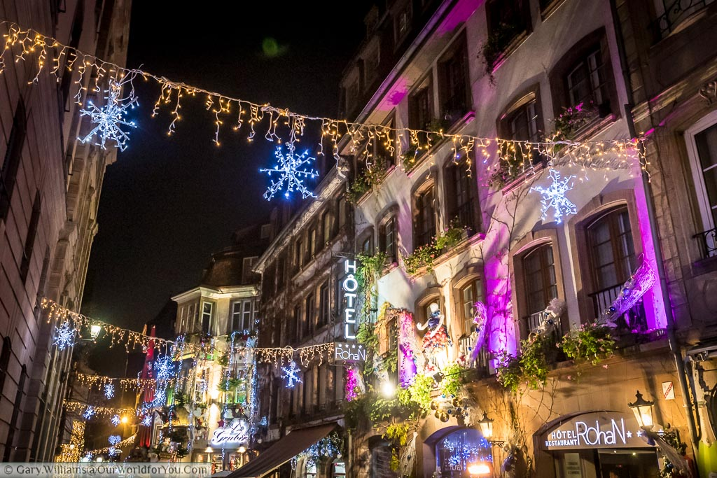 The illuminated Rue du Maroquin in Strasbourg, full of Christmas lights and decorations strung between building.