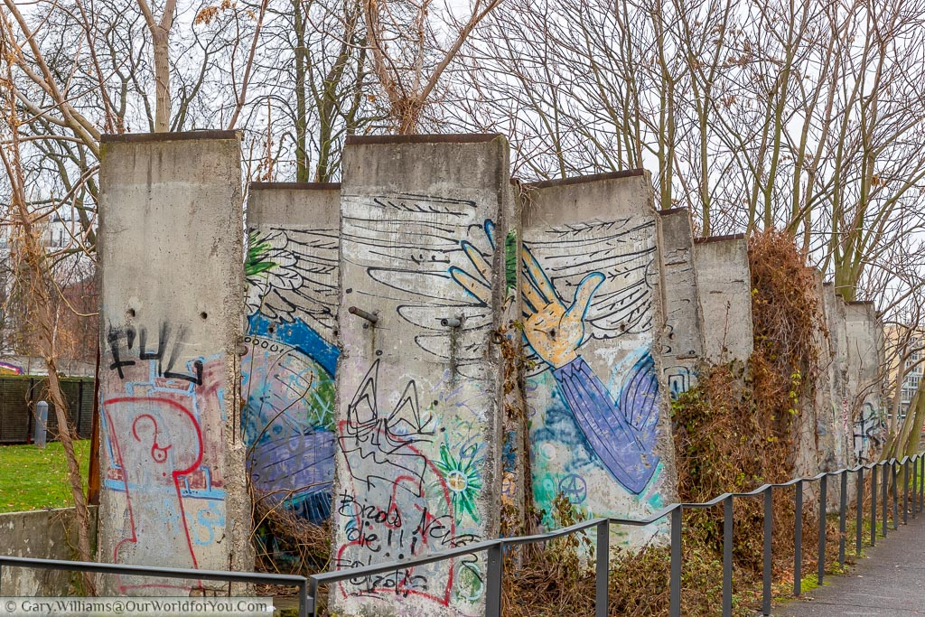 Graphittied sections of the Berlin Wall arranged in two-columns