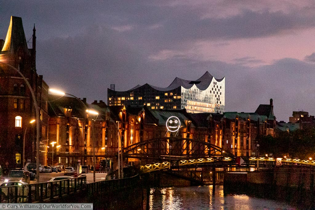 The top of the Elbphilharmonie from the Speicherstadt district of Hamburg after the sun has gone down in the evening.