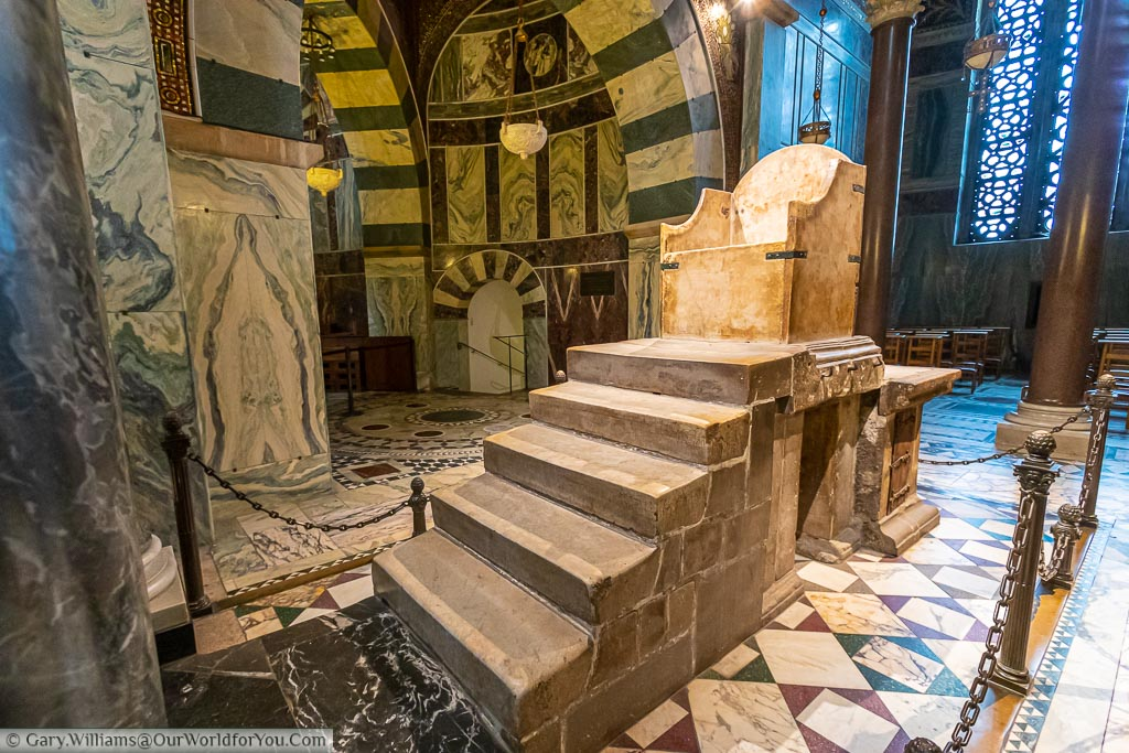 The throne of Charlemagne.  The throne is a straightforward stone construction, on the level above the congregation, where all Holy Roman Emperors were crowned until the early 16th century.