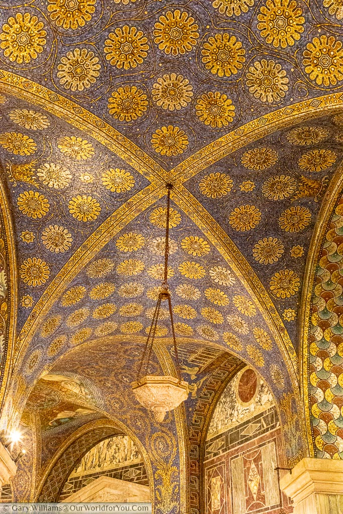 The blue and gold vaulted arches of the Dom are constructed of tiny bits of tile in a mosaic style.