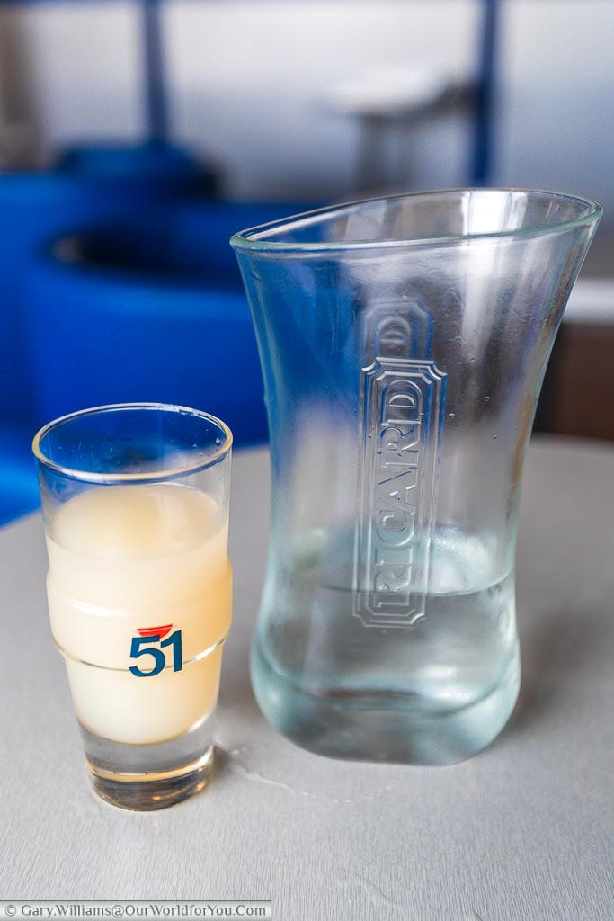 Glass of record served with a jug of water for you to mix as you desire.  Once you mix the 2 clear liquids the resulting drink turns a cloudy whitish colour