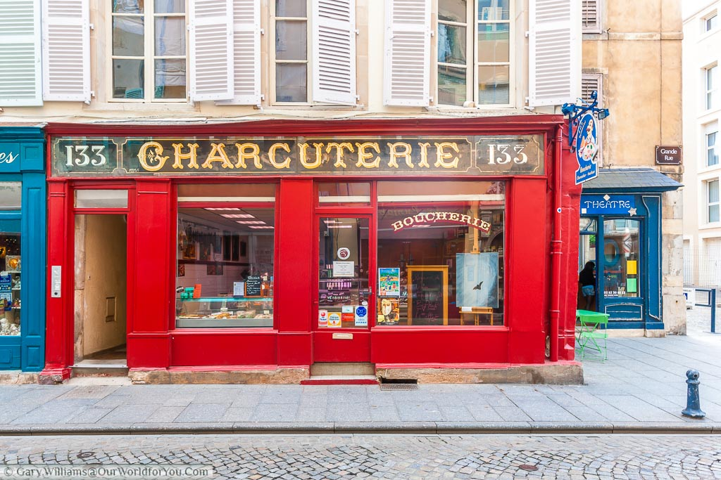 A traditional Charcuterie shop, painted bright red, in the historic town of Troyes