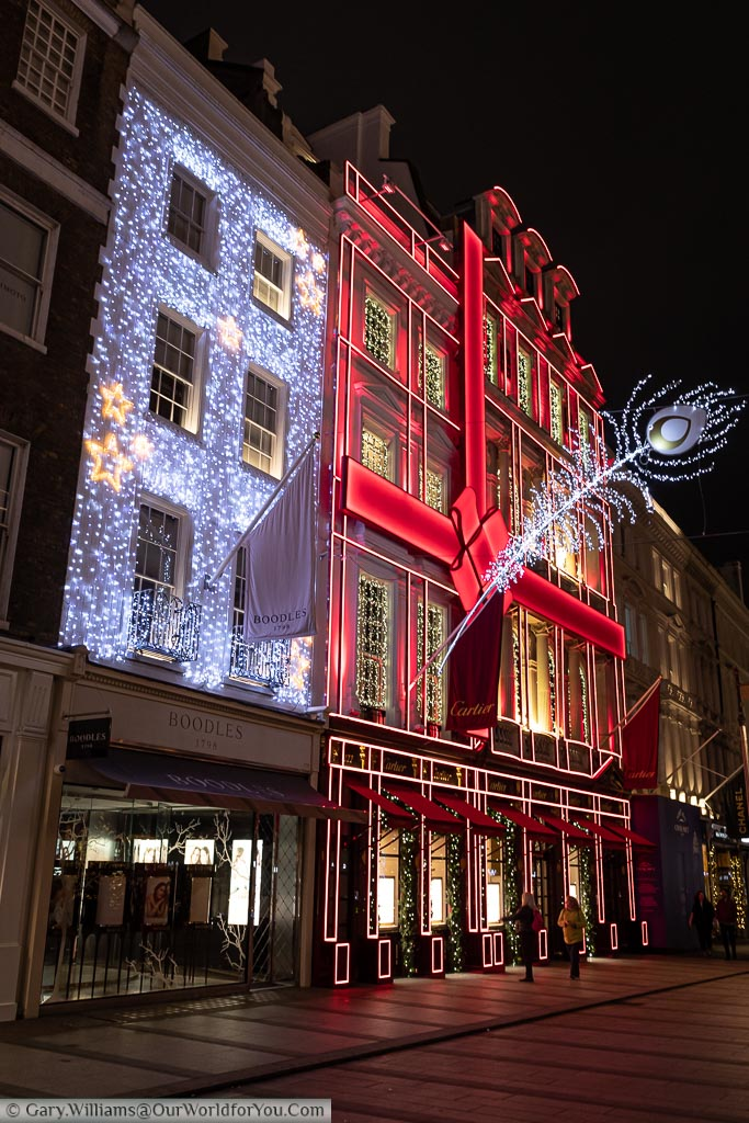Two beautifully decorated stores, ready for Christmas, in London's New Bond Street early in the evening