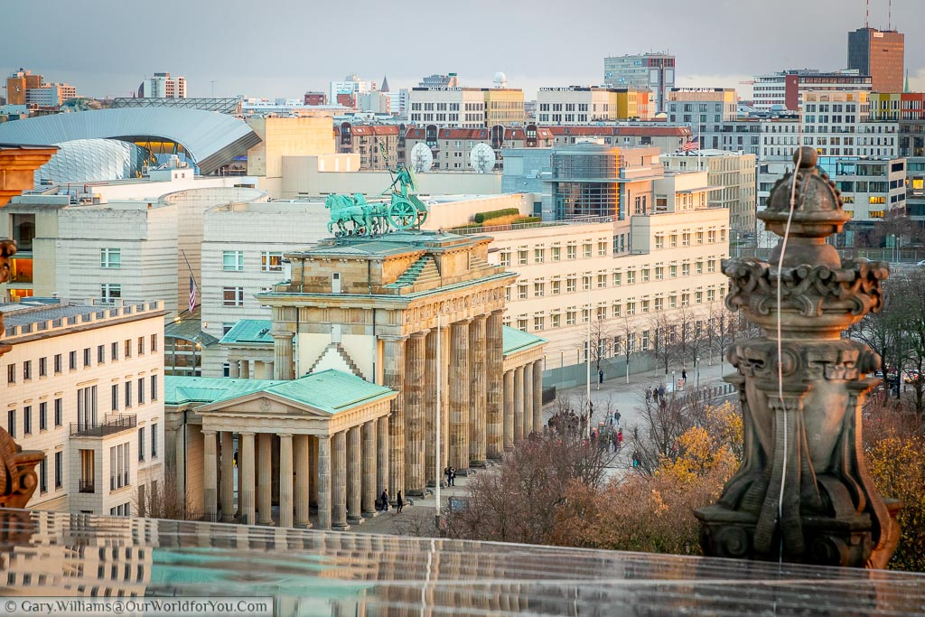 A view of the Brandenburg gate from the rooftop of the Reichstag, with the American embassy in the background.