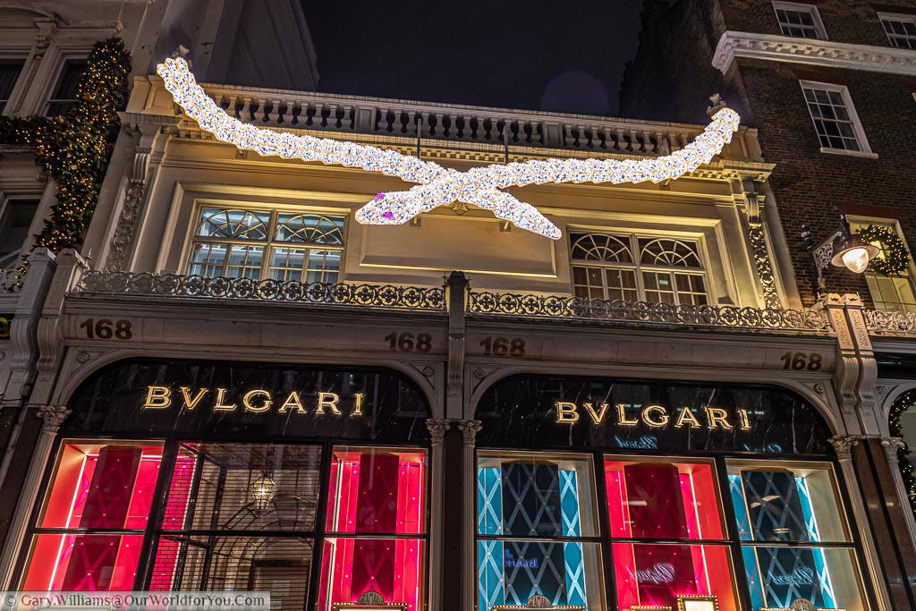 An illuminated white serpent with amethyst eyes above the Bulgari store in London's New Bond Street.