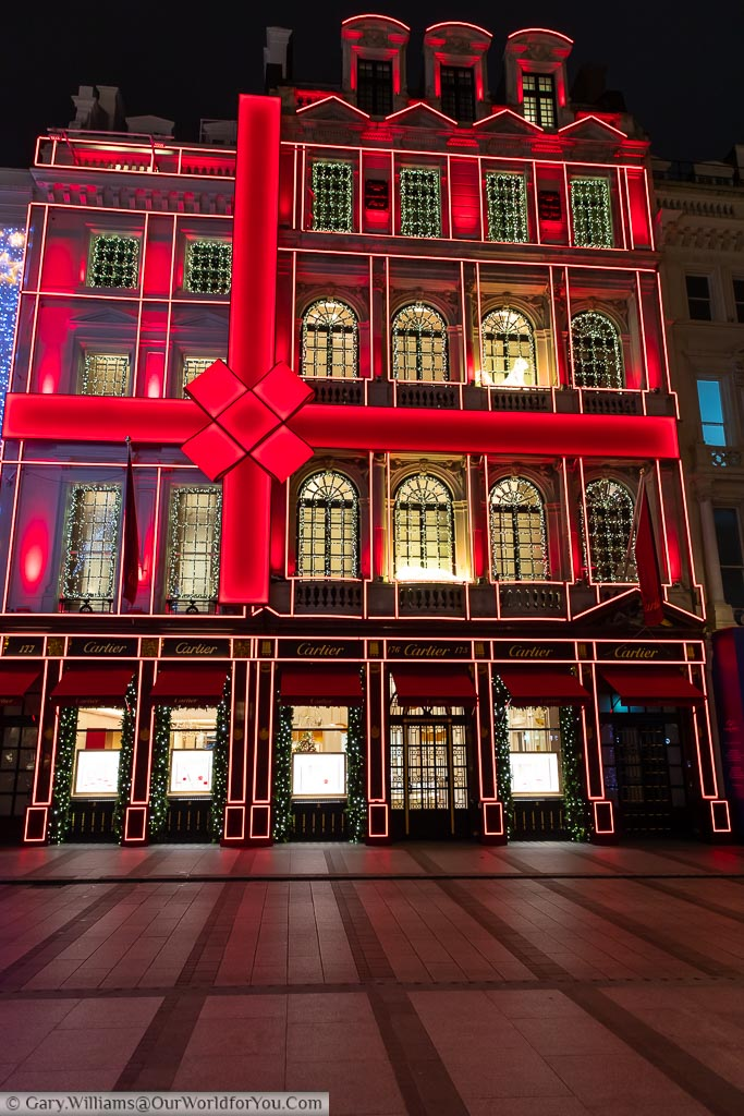 The Cartier store in London's New Bond Street, decorated as a giant Christmas present, tied up with an illuminated red bow.