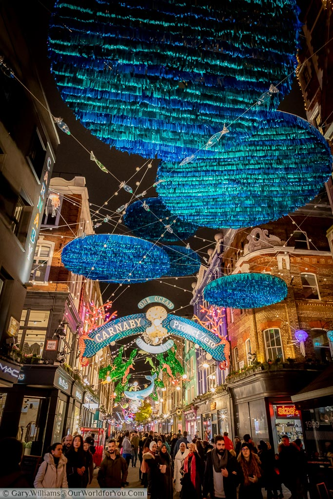 The illuminations above Carnaby Street with a One Ocean, One Planet theme as Christmas shoppers go about their festive fun.